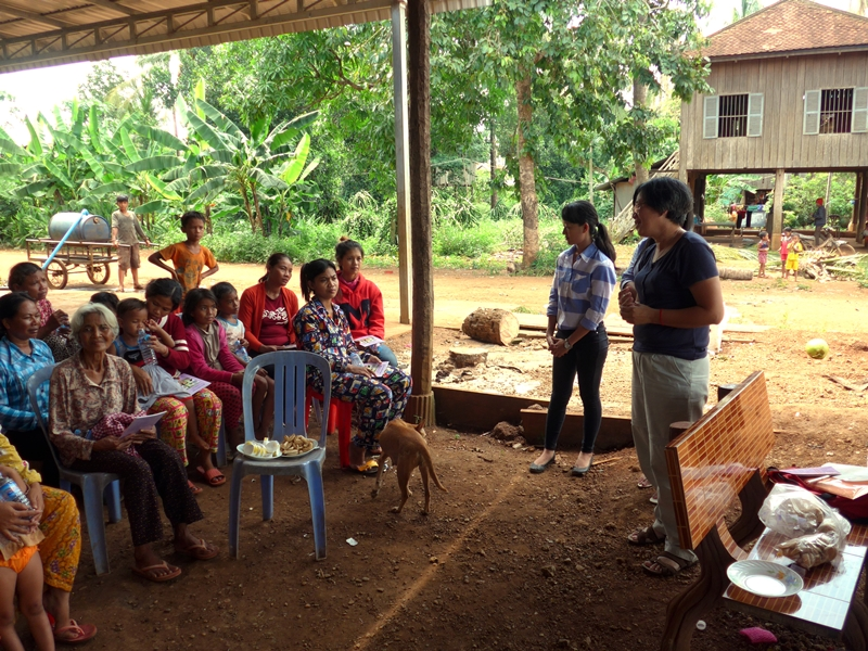Vichuta Ly and the Legal Services for Children and Women staff visit a village in Kampong Cham, Cambodia to raise awareness about human trafficking and labor laws in Thailand. 22 August 2016.  © 2016 Storm Tiv for GAATW
